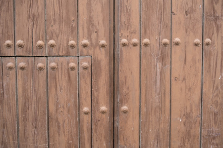 riveted: Full frame take of weathered riveted planks of a wooden door