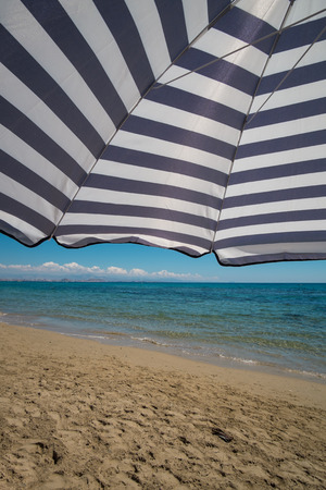 sunshade: Large sunshade against the background of a sunny beach Stock Photo