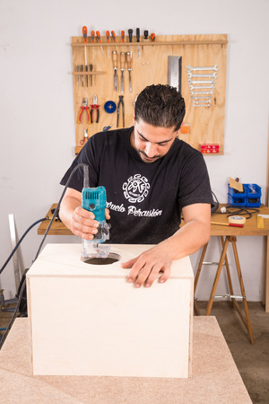 making music: Milling machine being used to craft a cajon flamenco percussion instrument Stock Photo