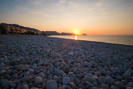 altea: Sunrise on the calm waters of Altea bay, Costa Blanca, Spain Stock Photo