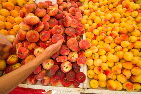 market stall: Fresh apricots and peaches on a street market stall