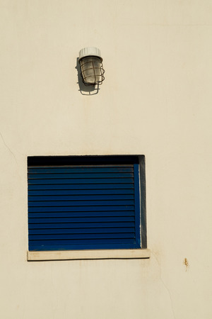 whitewashed: Mediterranean blue window on a whitewashed wall Stock Photo