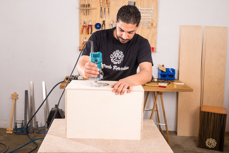 milling machine: Milling machine being used to craft a cajon flamenco percussion instrument Stock Photo