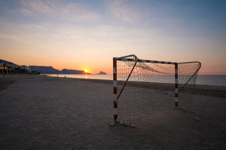 altea: Beach soccer goals on Altea bay at sunrise