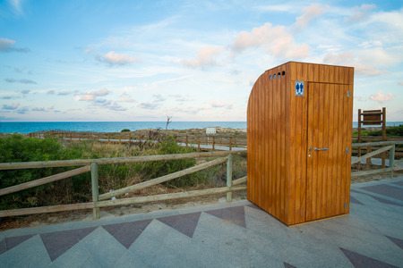 Wooden toilet booth on a beach promenade