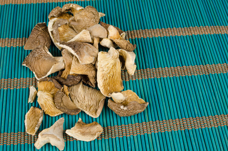 Dehydrated oyster mushrooms on a traditional bamboo mat