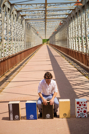 percussionist: Flamenco musician with an assortment of cajon instruments Editorial