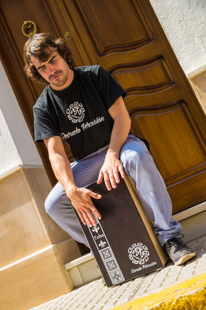 stetting: Flamenco percussionist playing a cajon in an Andalusian street stetting. Editorial