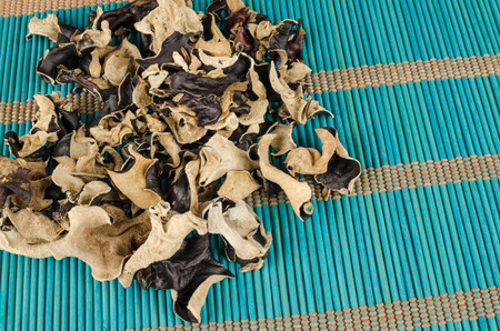 gilled: Dehydrated jews ear mushrooms on a bamboo mat Stock Photo