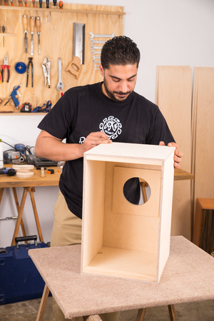 percussion instrument: Artisan working on a cajon flamenco percussion instrument Editorial