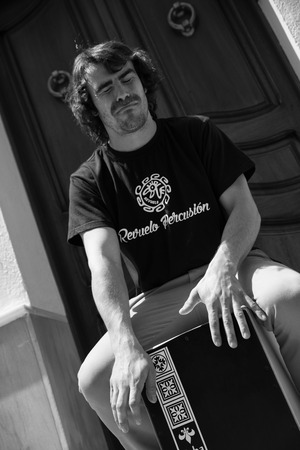percussionist: Flamenco musicial playing cajon on an Andalusian street