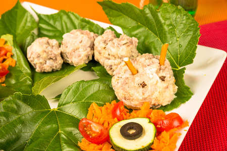 infantile: Meatball worm served with vegetables, a creative kid meal Stock Photo