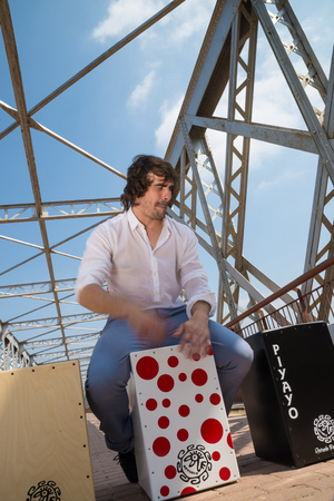 percussionist: Flamenco drummer sitting on a traditional cajon