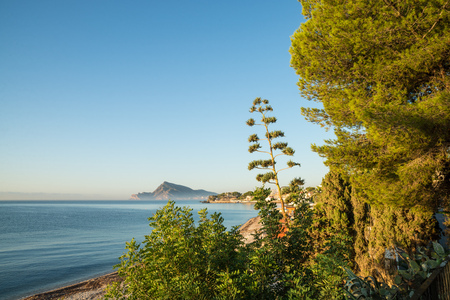 altea: The calm waters of Altea Bay on a sunny morning Stock Photo