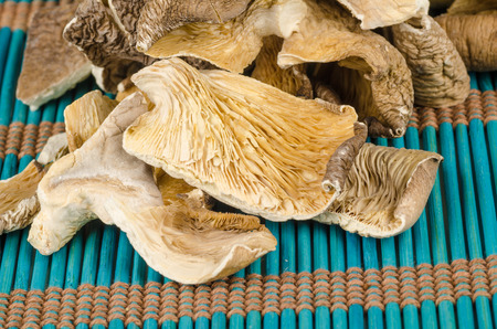 chinese cuisine: Dehydrated oyster mushrooms on a traditional bamboo mat