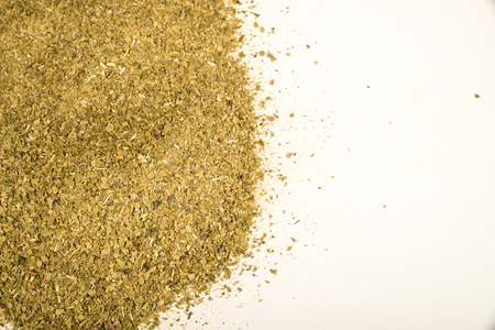 mate infusion: Heap of traditional yerba mate isolated on white