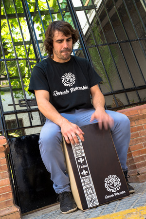 percussionist: Flamenco percussionist playing a cajon in an Andalusian street stetting. Stock Photo