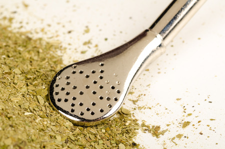 drinking straw: Heap of mate herb with traditional  steel drinking straw Archivio Fotografico