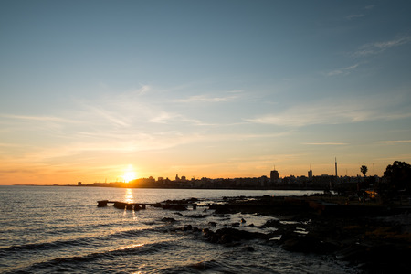 montevideo: Sunset over Rio de la Plata with Montevideo skyline in the background