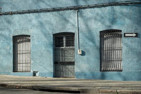 aguada: Charming Montevideo Ciudad Vieja facade with wintery tree branch shadows