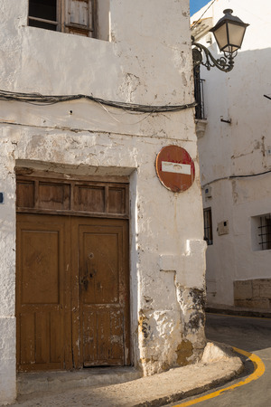 altea: Whitewashed facades and old street lights and traffic signs in Altea,  Costa Blanca, Spain