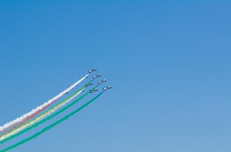 squad: SAN JAVIER, SPAIN, OCTOBER18, 2015: Italian squad Frecce Tricolori taking part in the celebration of  Spanish Patrulla Aguila squad 30th anniversary Editorial