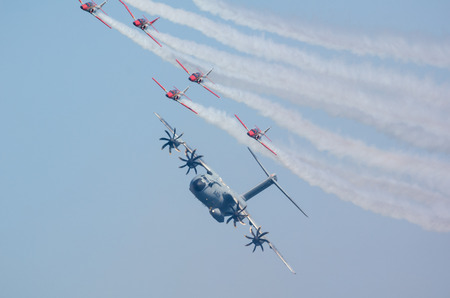 escuadra: SAN JAVIER, SPAIN, OCTOBER18, 2015: Airbus A400M airlifter escorted by Sains Patulla Aguila squad on their  30th anniversary celebration event.