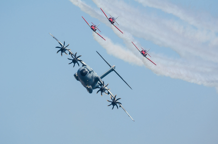SAN JAVIER, SPAIN, OCTOBER18, 2015: Airbus A400M airlifter escorted by Sains Patulla Aguila squad on their  30th anniversary celebration event.