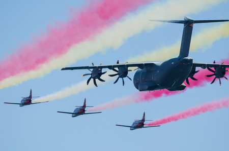 squad: SAN JAVIER, SPAIN, OCTOBER18, 2015: Airbus A400M airlifter escorted by Sains Patulla Aguila squad on their  30th anniversary celebration event.