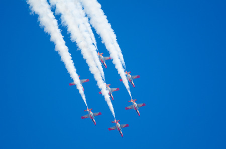 escuadra: SAN JAVIER, SPAIN, OCTOBER 18, 2015: Spanish acrobatic squad Patrulla Aguila performing on their 30th anniversary celebration event