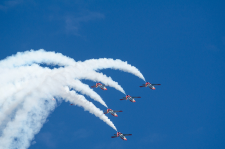 squad: SAN JAVIER, SPAIN, OCTOBER 18, 2015: Spanish acrobatic squad Patrulla Aguila performing on their 30th anniversary celebration event