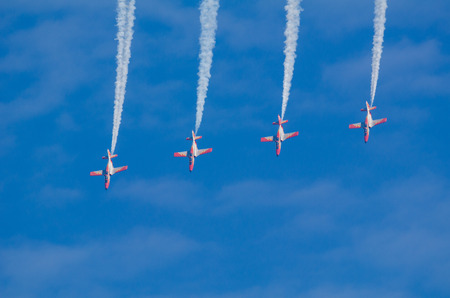 squadron: SAN JAVIER, SPAIN, OCTOBER 18, 2015: Spanish military acrobatic squadron  Patrulla Aguila performing on their 30th anniversary celebration Editorial
