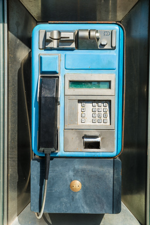 payphone: Old payphone in working order inside a phone box Stock Photo