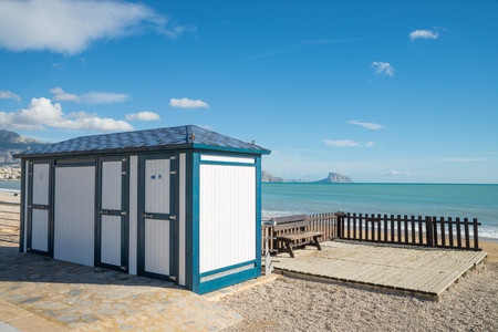 resort beach: Toiltet booth in the shape of a beach hut on a Mediterranean resort beach