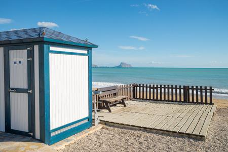 albir: Toiltet booth in the shape of a beach hut on a Mediterranean resort beach