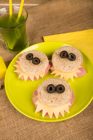 for kids: Scary monster sandwiches with olive eyes, creative food for kids Stock Photo