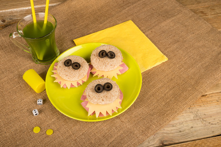infantile: Scary monster sandwiches with olive eyes, creative food for kids Stock Photo