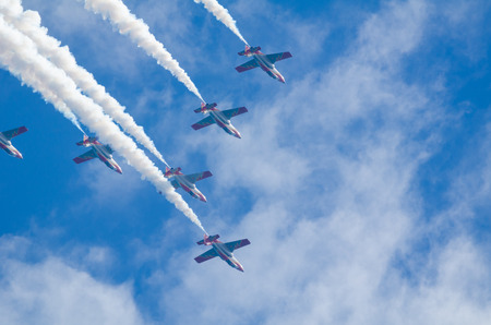 squadron: SAN JAVIER, SPAIN, OCTOBER18, 2015: Spanish military acrobatic squadron  Patrulla Aguila performing on their 30th anniversary celebration Editorial