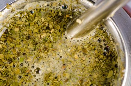 mate infusion: Closeup take of a brewing mate herb tea