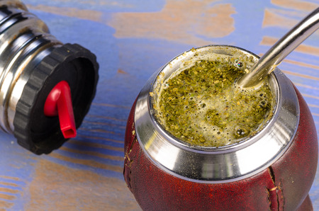 mate infusion: Mate herb brewing in its traditional gourd
