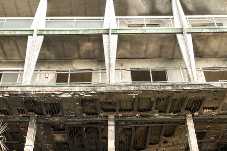 high rise building: Heavy fire damage on the facade of a high rise building