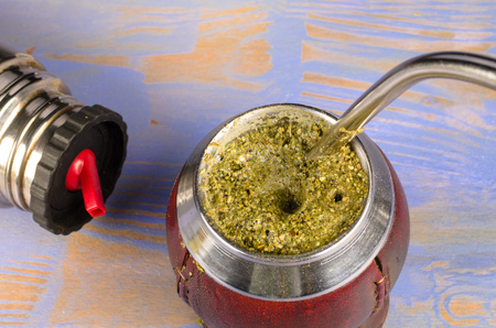 Mate herb brewing in its traditional gourd