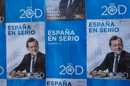 rajoy: MADRID, SPAIN-DECEMBER 4, 2015: Political campaign posters depicting conservative candidate and current President Rajoy on the kickoff day to the 2015 elections.