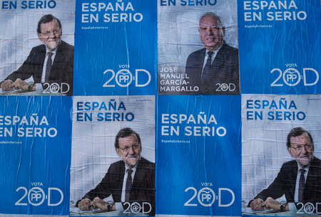 mariano: MADRID, SPAIN-DECEMBER 4, 2015: Political campaign posters depicting conservative candidate and current President Rajoy on the kickoff day to the 2015 elections.