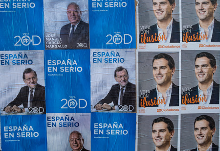 rajoy: MADRID, SPAIN-DECEMBER 4, 2015: Political campaign posters depicting current President Rajoy and opposition leader Rivera on the kickoff day to the 2015 elections.