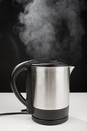 boiling: Hot boiling kettle letting out some steam