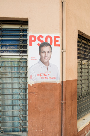 rajoy: ALICANTE, SPAIN-DECEMBER 5, 2015: Political campaign poster depicting oposition leader Pedro Sanchez on the kickoff to the 2015 elections.