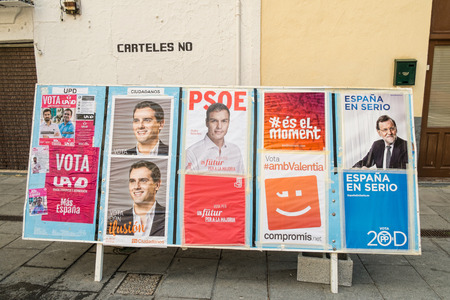 kickoff: ALICANTE, SPAIN-DECEMBER 5, 2015: Political campaign posterS depicting several presidential candidates on the kickoff to the 2015 elections. Editorial