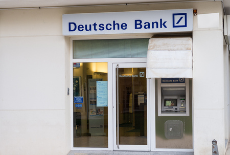 bank branch: ALICANTE, SPAIN - DECEMBER 14, 2015:  Deutsche Bank branch. Deutsche Bank is one of Europes leading banks and has been involved in some financial scandals recently