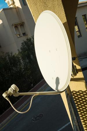 satelite: Domestic satelite dish on a home exterior Stock Photo